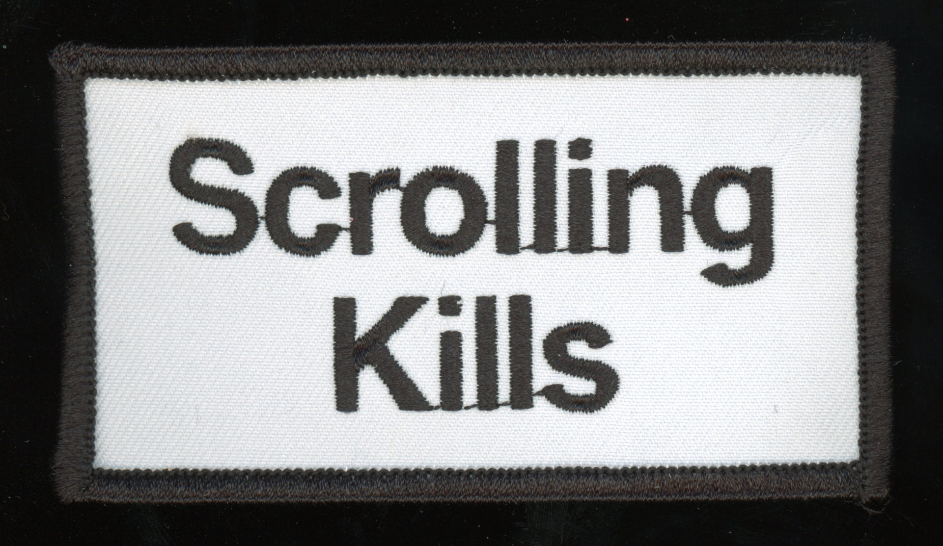 TXTbooks Scrolling Kills (Patch) – Kurt Woerpel